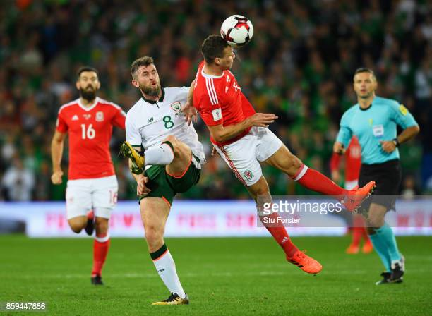 James Chester of Wales beats Daryl Murphy of the Republic of Ireland to the ball during the FIFA 2018 World Cup Group D Qualifier between Wales and...