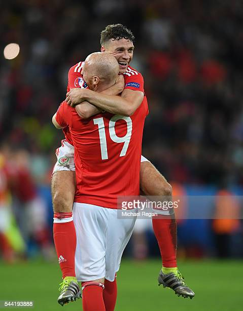 James Chester of Wales celebrates his team's 31 win with his team mate James Collins after the UEFA EURO 2016 quarter final match between Wales and...