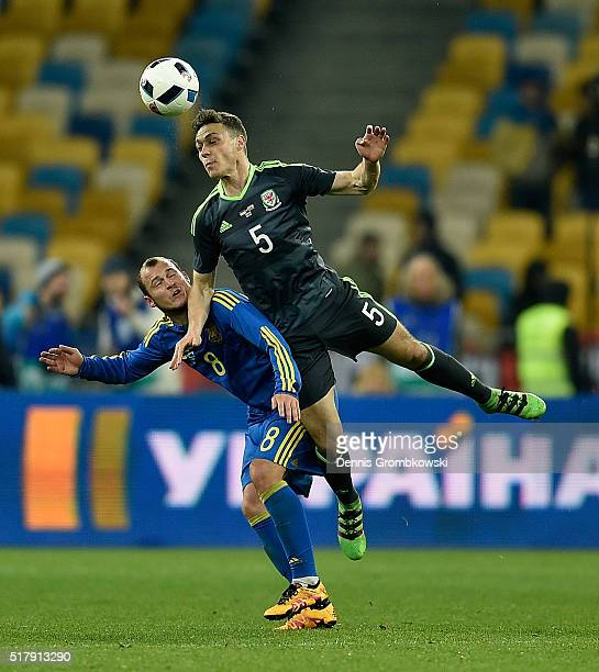 James Chester of Wales goes up for a header under the pressure of Roman Zozulya of Ukraine during the International Friendly match between Ukraine...
