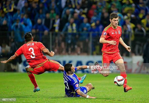 James Chester of Wales in action against Milan Djuric of Bosnia during the Euro 2016 qualifying football match between Bosnia and Herzegovina and...