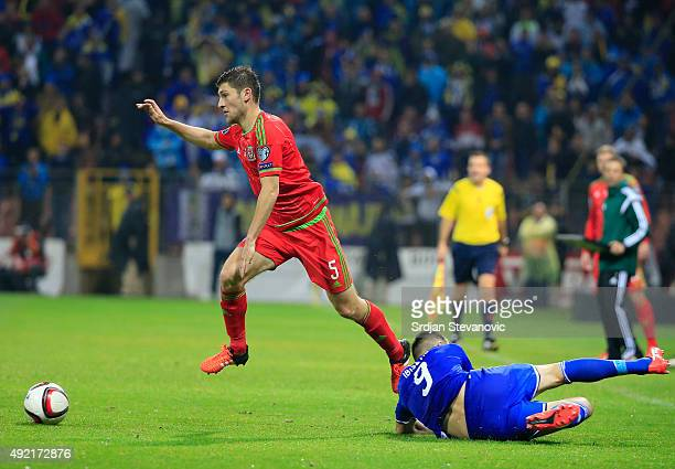 James Chester of Wales is tackled by Vedad Ibisevic of Bosnia during the Euro 2016 qualifying football match between Bosnia and Herzegovina and Wales...