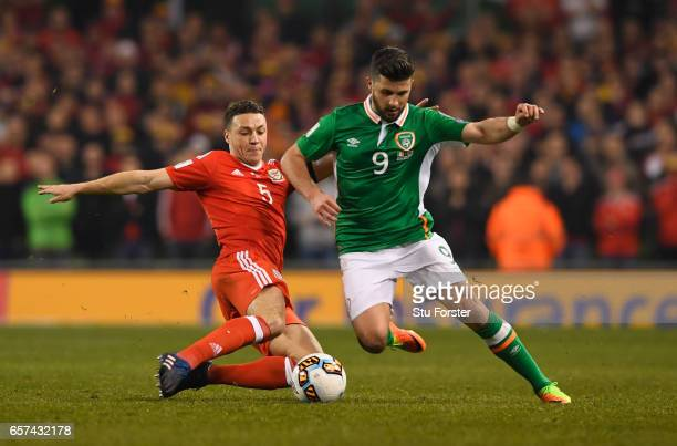 James Chester of Wales stretches to tackle Shane Long of the Republic of Ireland during the FIFA 2018 World Cup Qualifier between Republic of Ireland...