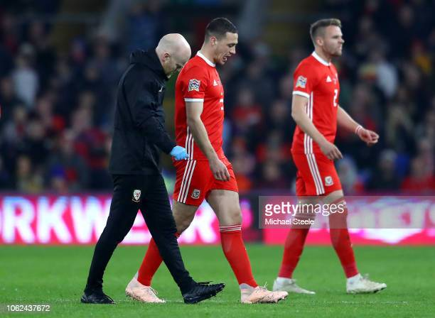 James Chester of Wales walks off injured during the UEFA Nations League Group B match between Wales and Denmark at Cardiff City Stadium on November...