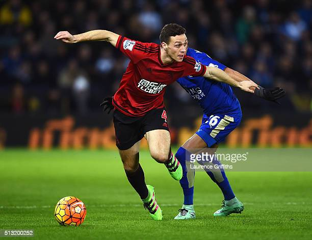 James Chester of West Bromwich Albion and Riyad Mahrez of Leicester City compete for the ball during the Barclays Premier League match between...