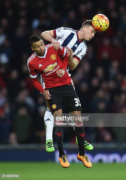 James Chester of West Bromwich Albion wins a header with Jesse Lingard of Manchester United during the Barclays Premier League match between West...