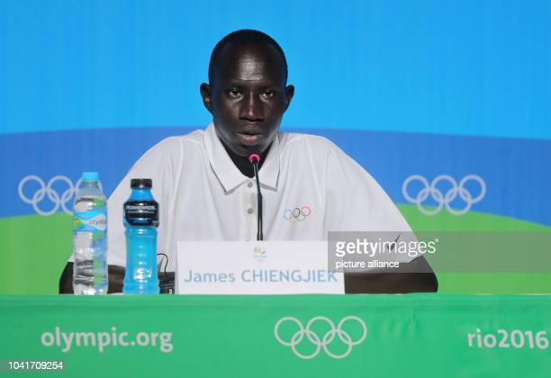 James Chiengjiek from South Sudan of the Olympic Refugee Team for Athletics, attends a news conference at the Main Press Centre at Olympic Parc Barra...