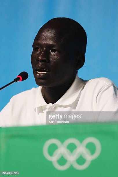 James Chiengjiek of the Olympic Refugee Team talks while attending a press conference given by the Olympic Refugee Team on July 31, 2016 in Rio de...