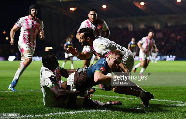 James Chisholm of Harlequins dives over for his side's fifth try during the European Rugby Challenge Cup match between Harlequins and Stade Francais...