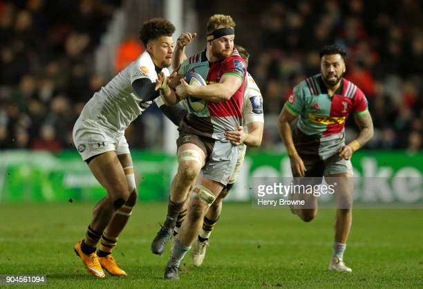 James Chisholm of Harlequins tackled by Guy Armitage of Wasps during the European Rugby Champions Cup match between Harlequins and Wasps at...