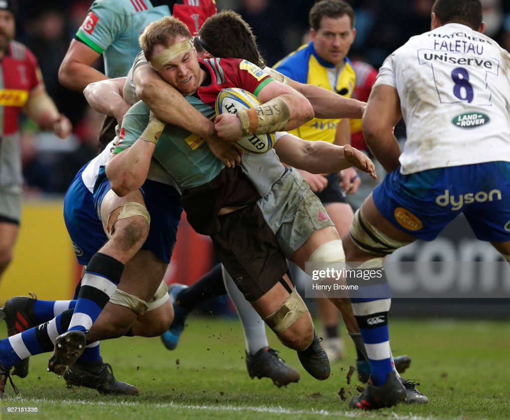 James Chisholm of Harlequins tackled by Josh Bayliss of Bath Rugby during the Aviva Premiership match between Harlequins and Bath Rugby at Twickenham Stoop on March 4, 2018 in London, England.