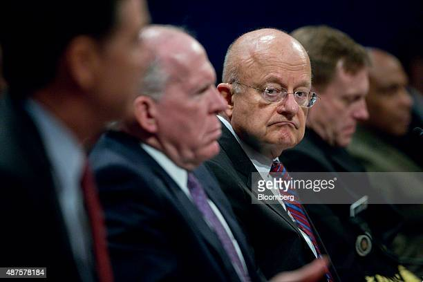 James Clapper director of National Intelligence center looks on a James Comey director of the Federal Bureau of Investigation left speaks during a...