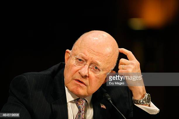 James Clapper Director of National Intelligence testifies during a Senate Armed Services Committee meeting at the Dirksen Senate Office Building on...