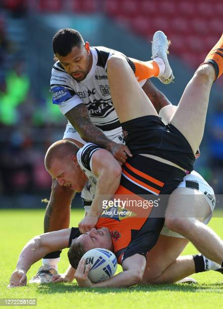James Clare of Castleford Tigers is tackled by Brad Fash of Hull FC during the Coral Challenge Cup Sixth Round match between Castleford Tigers and...