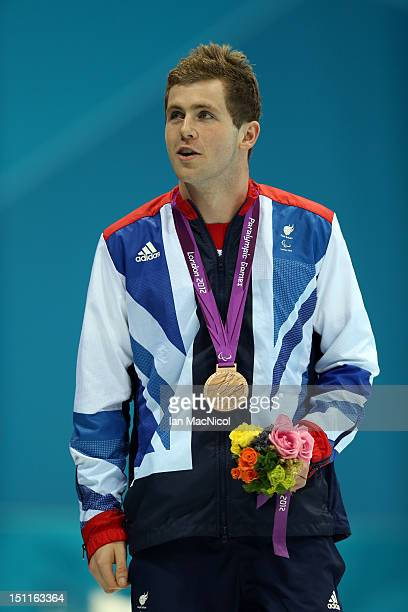 James Clegg of Great Britain with his bronze medal from the Men's 100m Butterfly - S12 on day four of the London 2012 Paralympic Games at the...