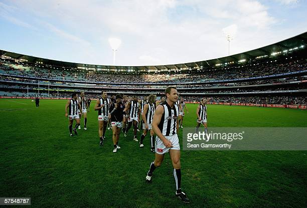 James Clement for Collingwood walks his team off after completing his 200th game after the round six AFL match between the Carlton Blues and the...