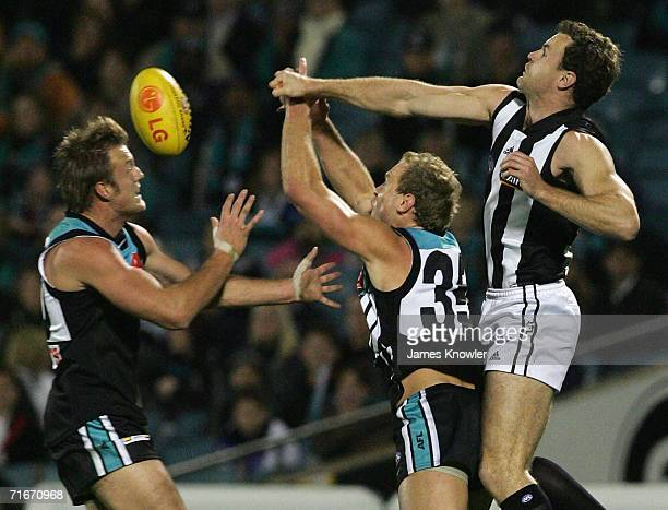 James Clement of the Magpies spoils over Chad Cornes and Dean Brogan of Port during the round 20 AFL match between the Port Adelaide Power and...