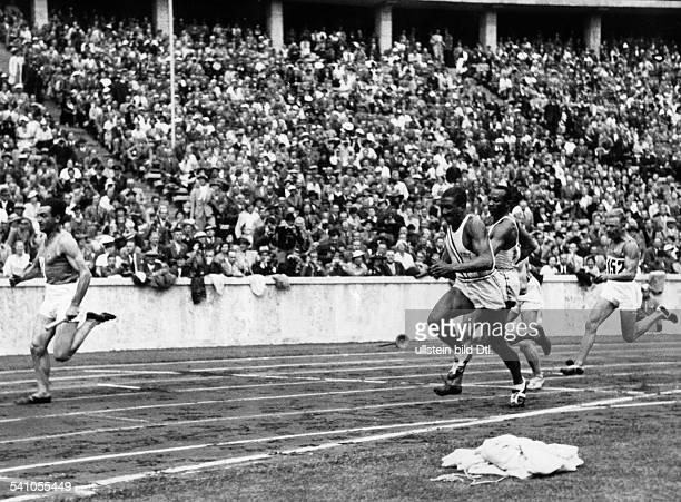 James Cleveland OWENS *19131980 American athlete 1936 Summer Olympics in Berlin athletics 4x100 meters relay final Olympic champions Jesse Owens and...
