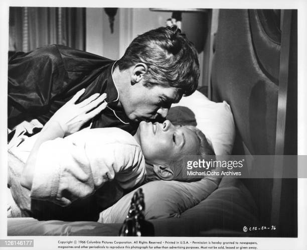 James Coburn and Camilla Sparv sharing intimate moment in a scene from the film 'Dead Heat On A Merry Go Round' 1966