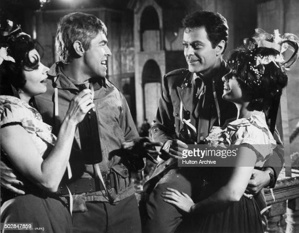 James Coburn Dick Shawn and Giovanna Ralli have a drink in a scene from the movie What Did You Do in the War Daddy circa 1966