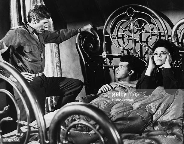 James Coburn Dick Shawn and Giovanna Ralli talk in a scene from the movie What Did You Do in the War Daddy circa 1966