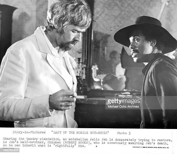 James Coburn talking to his halfbrother Robert Hooks in a scene from the film 'Last Of The Mobile Hot Shots' 1970