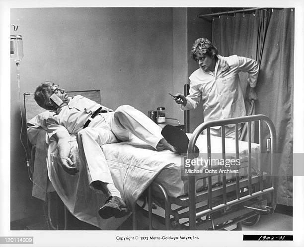 James Coburn tries to get away from Michael Blodgett in a scene from the film 'The Carey Treatment' 1972