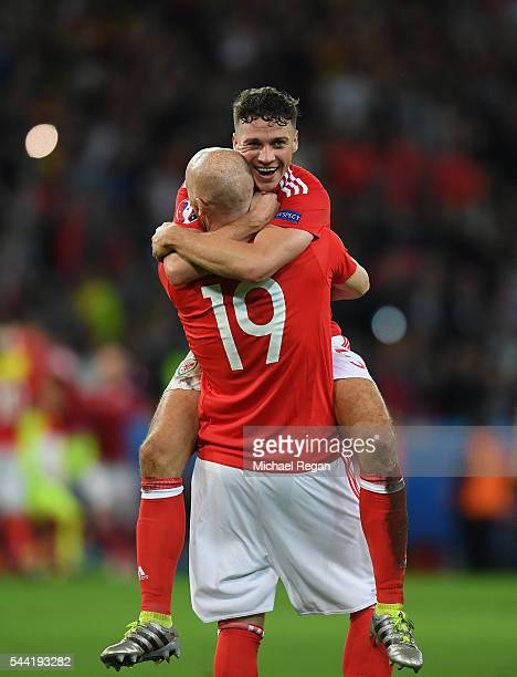 James Collins and James Chester of Wales celebrate their team's 31 win in the UEFA EURO 2016 quarter final match between Wales and Belgium at Stade...