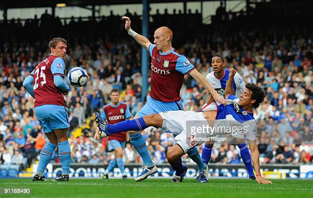James Collins of Aston Villa challenges Franco Di Santo of Blackburn during the Barclays Premier League match between Blackburn Rovers and Aston...