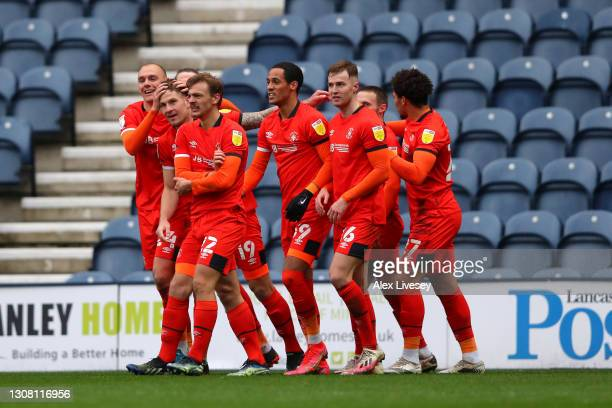 James Collins of Luton Town and team-mates celebrate after a own goal by Daniel Iversen of Preston for their team's first goal during the Sky Bet...