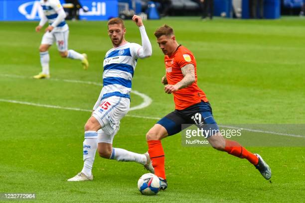 James Collins of Luton town battles for possession with Sam Field of QPR during the Sky Bet Championship match between Queens Park Rangers and Luton...
