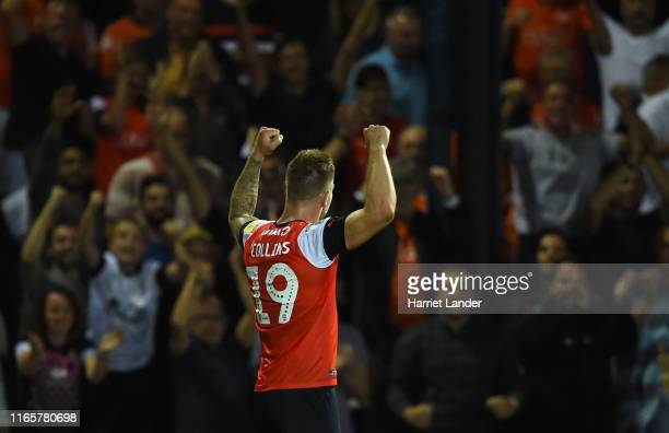 James Collins of Luton Town celebrates after scoring his team's third goal during the Sky Bet Championship match between Luton Town and Middlesbrough...