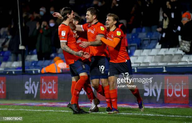 James Collins of Luton Town celebrates after scoring their sides third goal with Kiernan Dewsbury-Hall of Luton Town during the Sky Bet Championship...