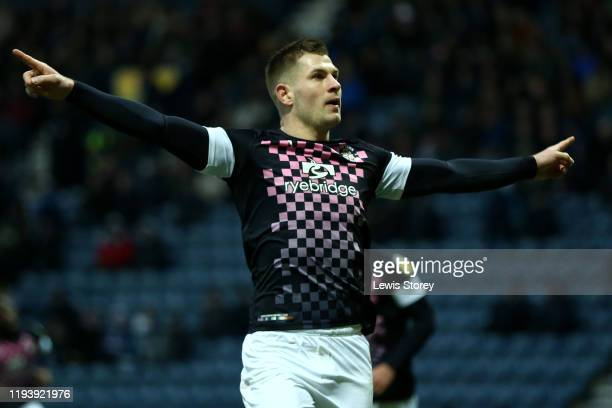 James Collins of Luton Town celebrates scoring his sides first goal during the Sky Bet Championship match between Preston North End and Luton Town at...