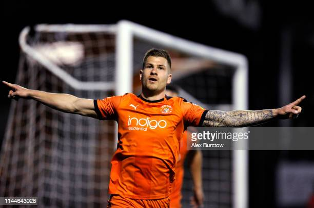 James Collins of Luton Town celebrates scoring his team's second goal during the Sky Bet League One match between Luton Town and AFC Wimbledon at...