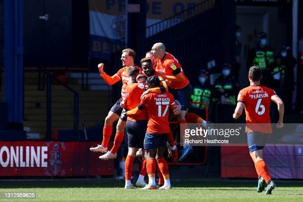James Collins of Luton Town celebrates with teammates after scoring their team's first goal from the penalty spot during the Sky Bet Championship...