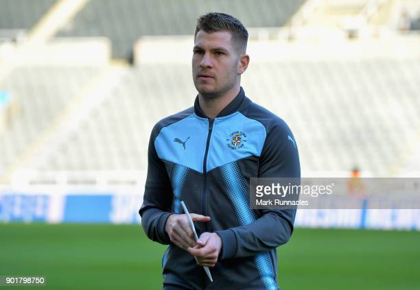 James Collins of Luton Town inspect the pitch prior to The Emirates FA Cup Third Round match between Newcastle United and Luton Town at St James'...