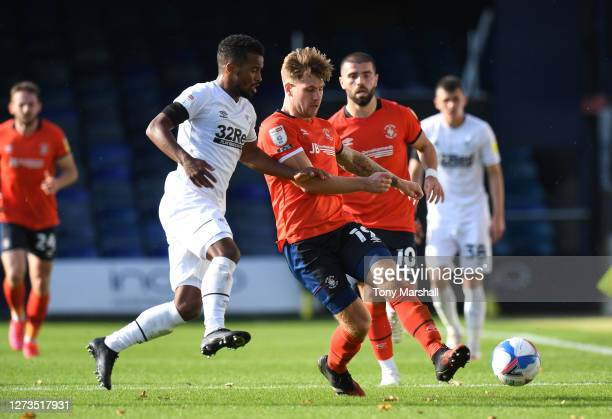 James Collins of Luton Town is challenged by Nathan Byrne of Derby County during the Sky Bet Championship match between Luton Town and Derby County...