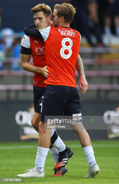 James Collins of Luton Town is congratulated by Luke Berry of Luton Town after scoring a penalty goal during the Sky Bet Championship match between...