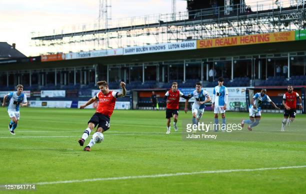 James Collins of Luton Town scores a penalty goal during the Sky Bet Championship match between Luton Town and Blackburn Rovers at Kenilworth Road on...