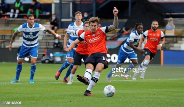 James Collins of Luton Town scores the first goal from the penalty spot during the Sky Bet Championship match between Luton Town and Queens Park...