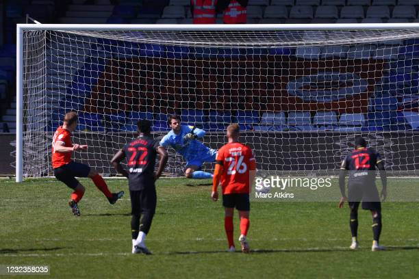 James Collins of Luton Town scores the opening goal from a penalty during the Sky Bet Championship match between Luton Town and Watford at Kenilworth...