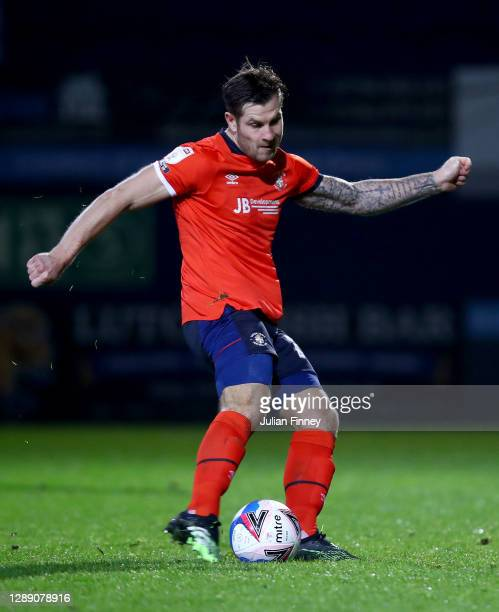 James Collins of Luton Town scores their sides third goal from the penalty spot during the Sky Bet Championship match between Luton Town and Norwich...