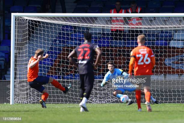 James Collins of Luton Town scores their team's first goal from the penalty spot past Daniel Bachmann of Watford FC during the Sky Bet Championship...