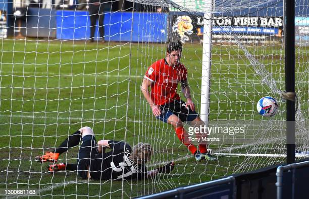 James Collins of Luton Town scoring their first goal during the Sky Bet Championship match between Luton Town and Huddersfield Town at Kenilworth...