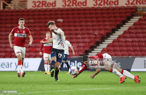 James Collins of Luton Town shoots as Sam Morsy of Middlesbrough gets a hand to the ball leading to a penalty and a red card during the Sky Bet...