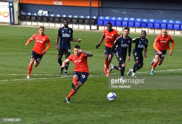 James Collins of Luton Town takes a penalty which was saved by Jordan Archer of Middlesbrough during the Sky Bet Championship match between Luton...