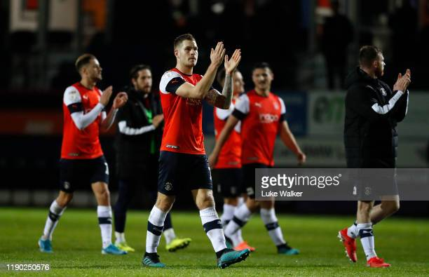 James Collins of Luton Town thanks the fans after his teams win during the Sky Bet Championship match between Luton Town and Charlton Athletic at...