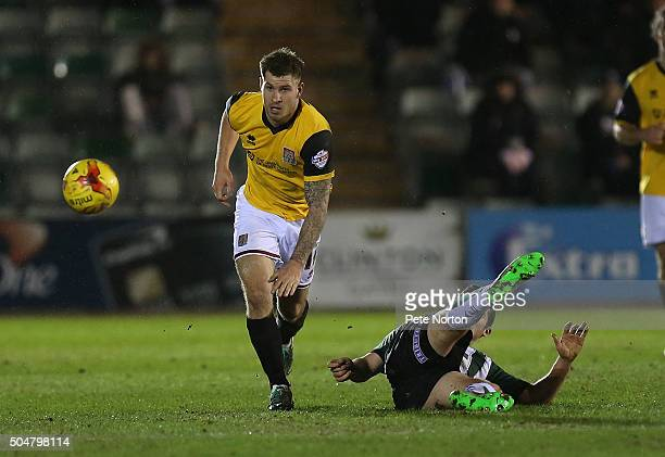 James Collins of Northampton Town moves away with the ball from the challenge of Carl McHugh of Plymouth Argyle during the Sky Bet League Two match...
