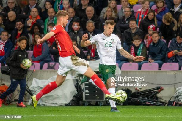 James Collins of Republic of Ireland battles for the ball with Nico Elvedi of Switzerland during the UEFA Euro 2020 qualifier between Switzerland and...