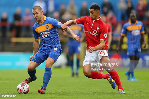 James Collins of Shrewsbury Town and Lewis Montrose of York City